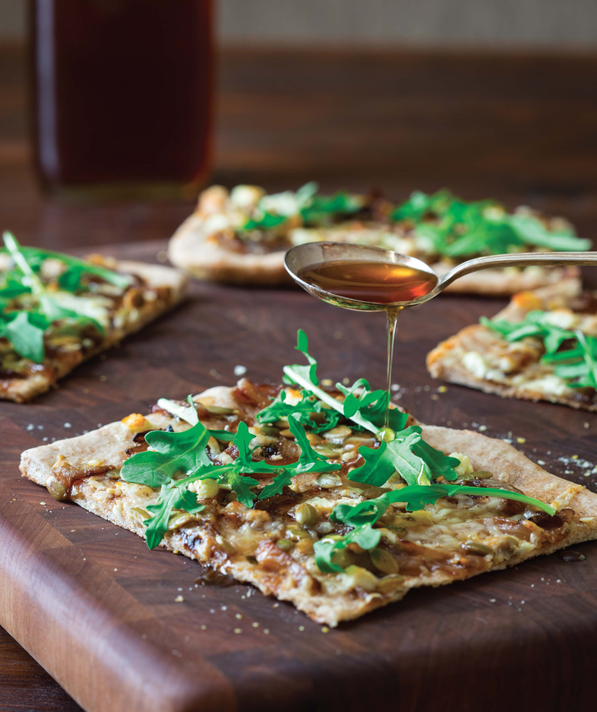 "Balsamic Caramelized Onion Pizza from ""Maple"" by Katie Webster."