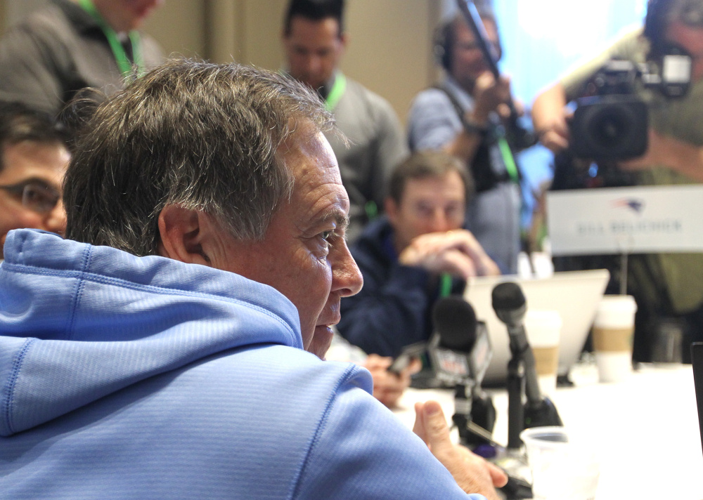 Bill Belichick, head coach of the New England Patriots, takes a question from the media at the NFL owners meeting in Boca Raton, Florida, on Tuesday.