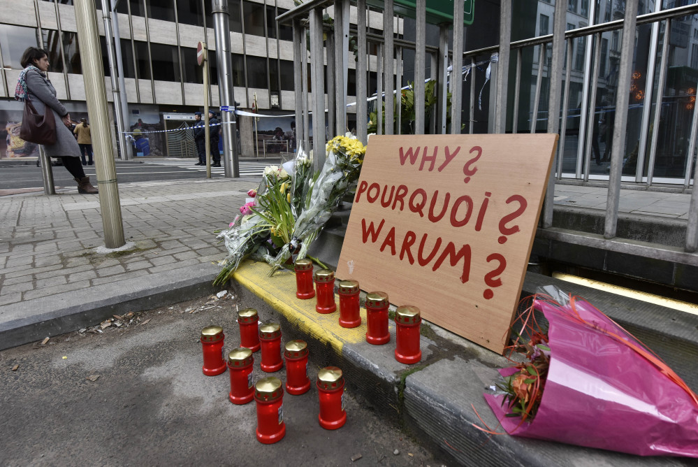 "A sign reading ""Why?"" is placed near the metro station Maelbeek in Brussels on Wednesday, a day after bombs exploded at the Brussels airport and the metro stations, killing and wounding scores of people. The Islamic State has trained a network of agile and semiautonomous cells to carry out such attacks, the Associated Press reports."
