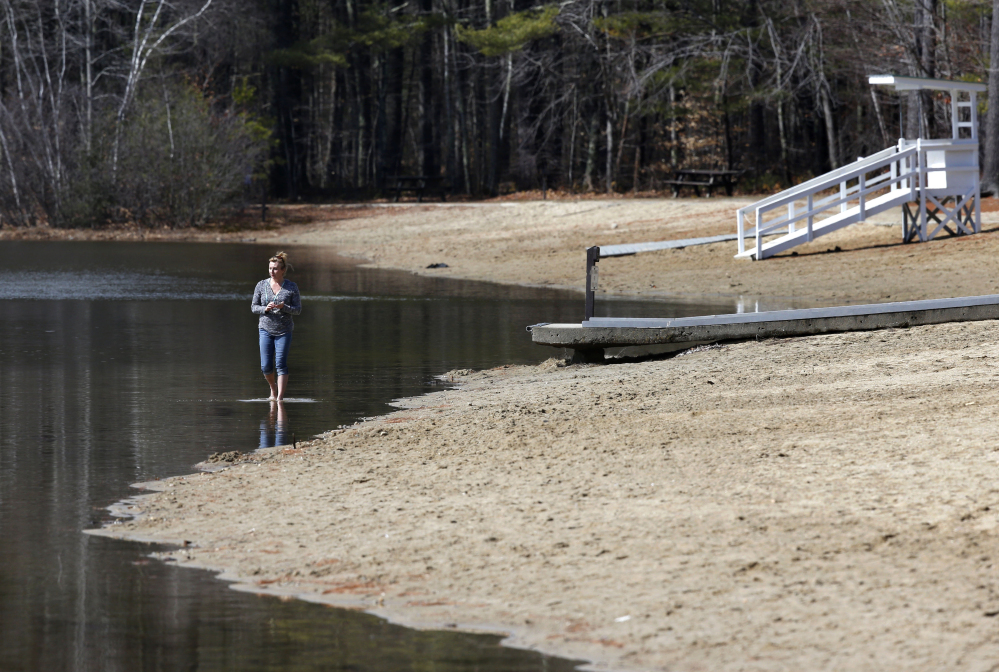 Roxanne Doyer of Mechanic Falls, Maine, walks barefoot in Lower Range Pond in Poland on March 17. Last year's mud season started late because of heavy snow, and lasted until mid-May in some parts of northern New England. But this year's mud season is already here in much of the three states, and meteorologists say it will likely be brief.
