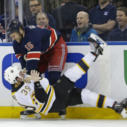 Fans react as Tanner Glass of the Rangers punches Boston's Matt Beleskey in the first period Wednesday in New York. The Rangers won, 5-2.