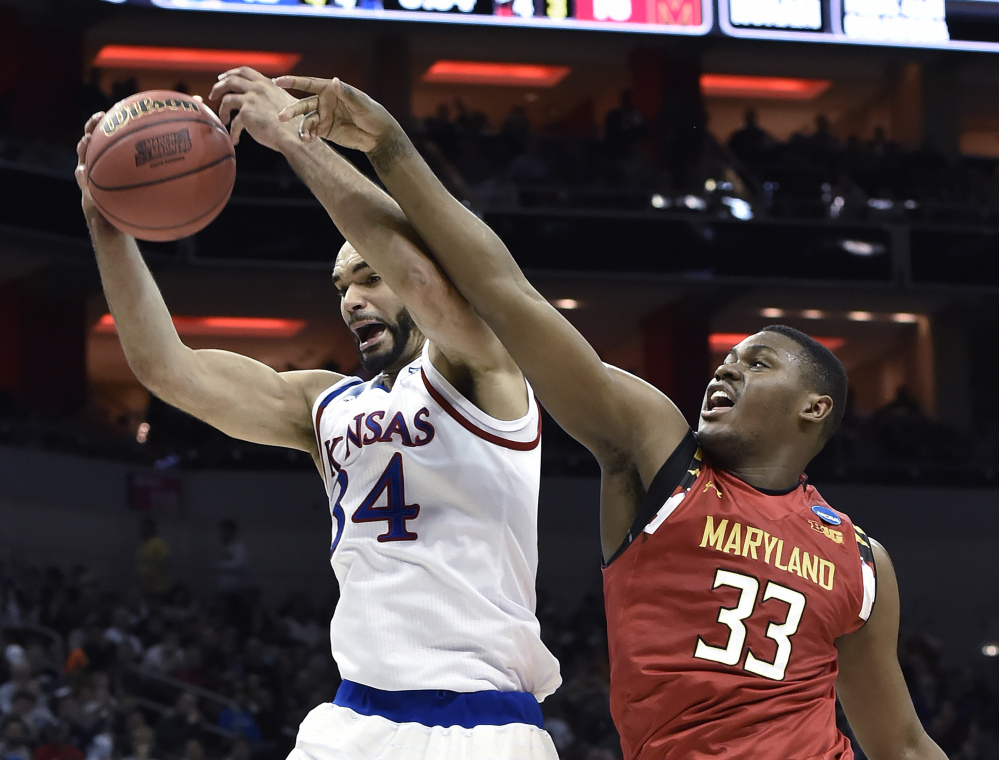 Kansas forward Perry Ellis pulls a rebound away from Maryland center Diamond Stone in the first half of Thursday night's regional semifinal game in Louisville, Ky. Ellis scored 27 points to lead Kansas.