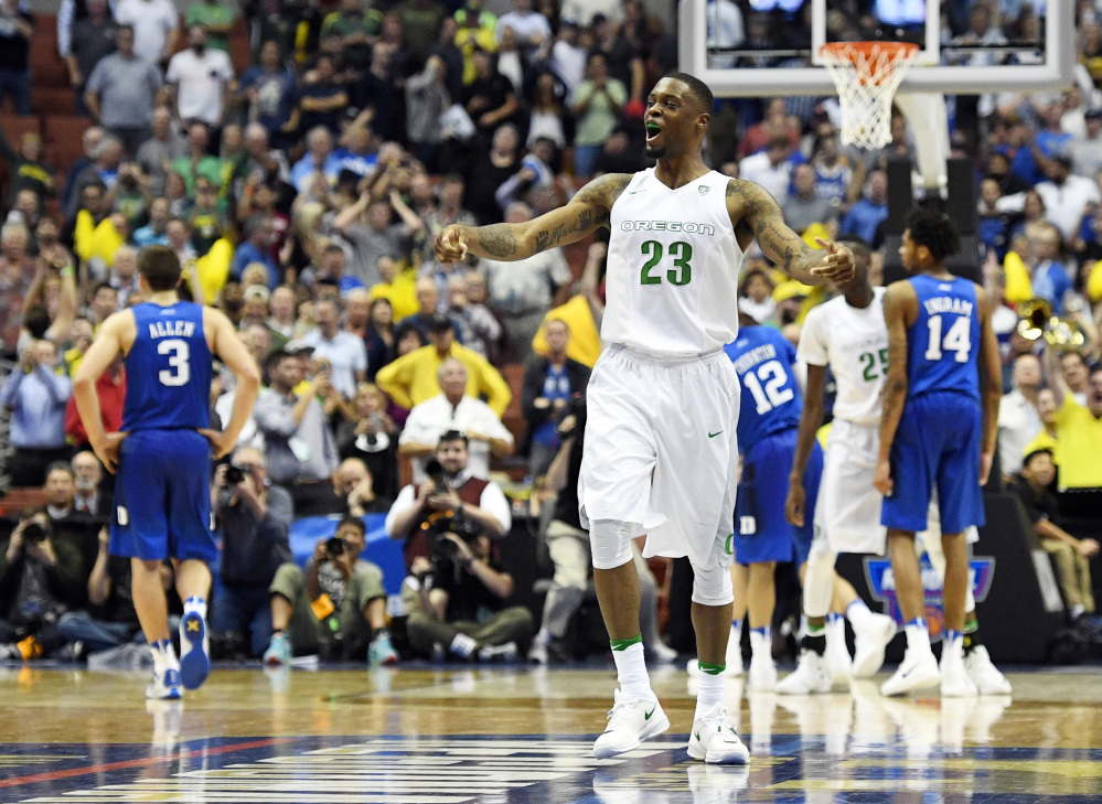 Oregon forward Elgin Cook celebrates the Ducks' win over Duke on Thursday night in the regional semifinals of the NCAA tournament in Anaheim, Calif. Cook had 16 points and nine rebounds in the game.