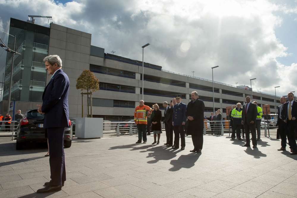 Secretary of State John Kerry stands in silence as he participates in wreath-laying at Brussels Airport in Brussels, Belgium, paying his respect to victims of terrorist attacks that left more than 30 dead at Brussels Airport.