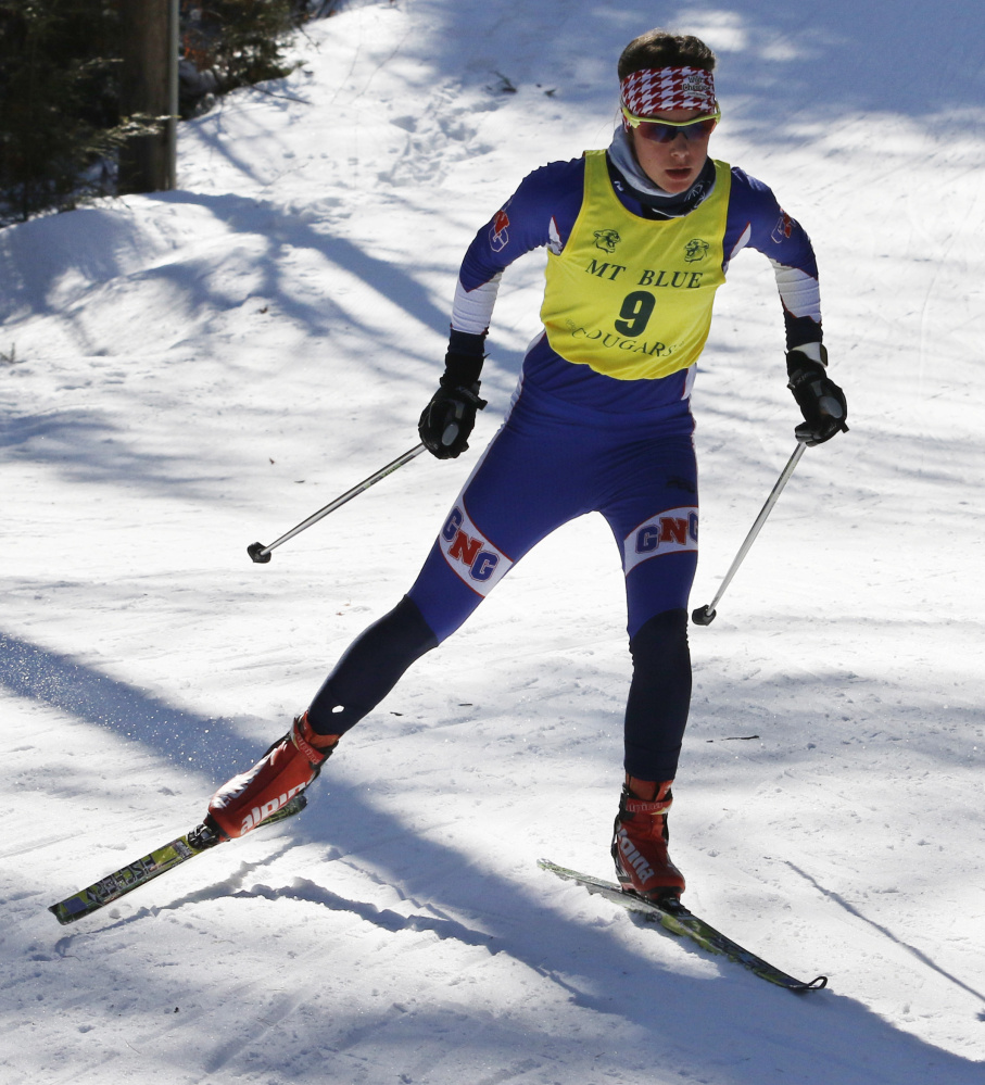 Kaelyn Woods of Gray-New Gloucester won the Class B freestyle state championship at Titcomb Mountain, completing a sweep of the  Nordic events for the third year in a row.
