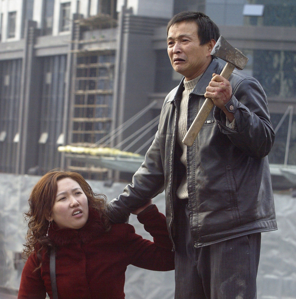 IPu Zhengxing, a carpenter trying to get back his unpaid wages, takes hostage the wife of his foreman in Shaanxi province. Police saved the hostage and arrested Pu.