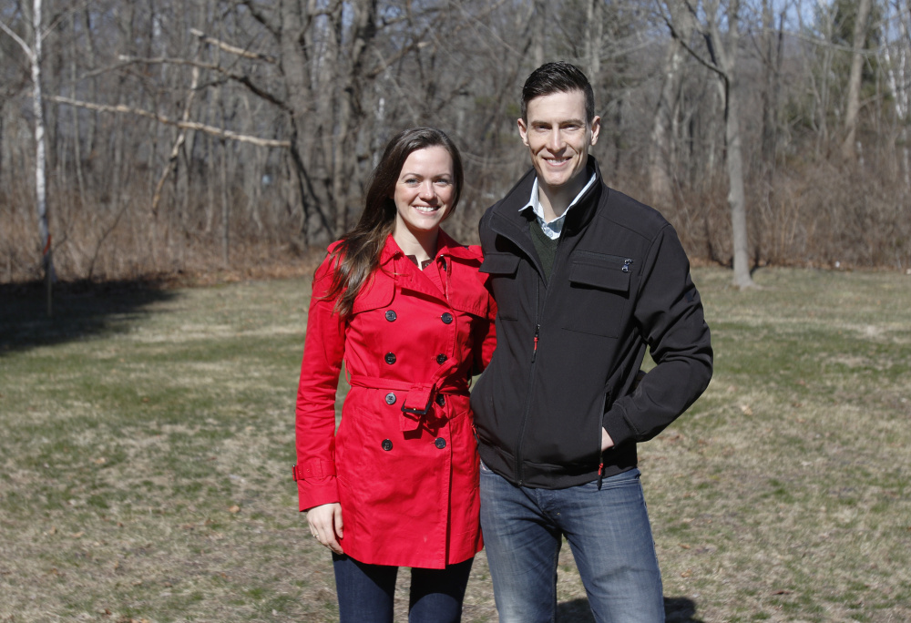 "Amber and Zev Myerowitz Jr. stand Sunday at the site where they want to build a medical office and apartment complex in Cape Elizabeth. ""We've basically designed the buildings that the town center planners wanted,"" Zev Myerowitz says. Joel Page/Staff Photographer"