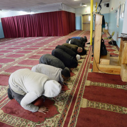 "Muslim men pray at their community center. Many people at the center were dismissive of presidential candidate Donald Trump and his talk about temporarily banning Muslims from the U.S. ""He has no sense of culture,"" said Abdiaziz Mohamed."