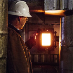 David Ettinger of ReEnergy Holdings opens a window into the biomass plant in Livermore Falls. The plants use waste wood to generate about a quarter of the state's electricity.