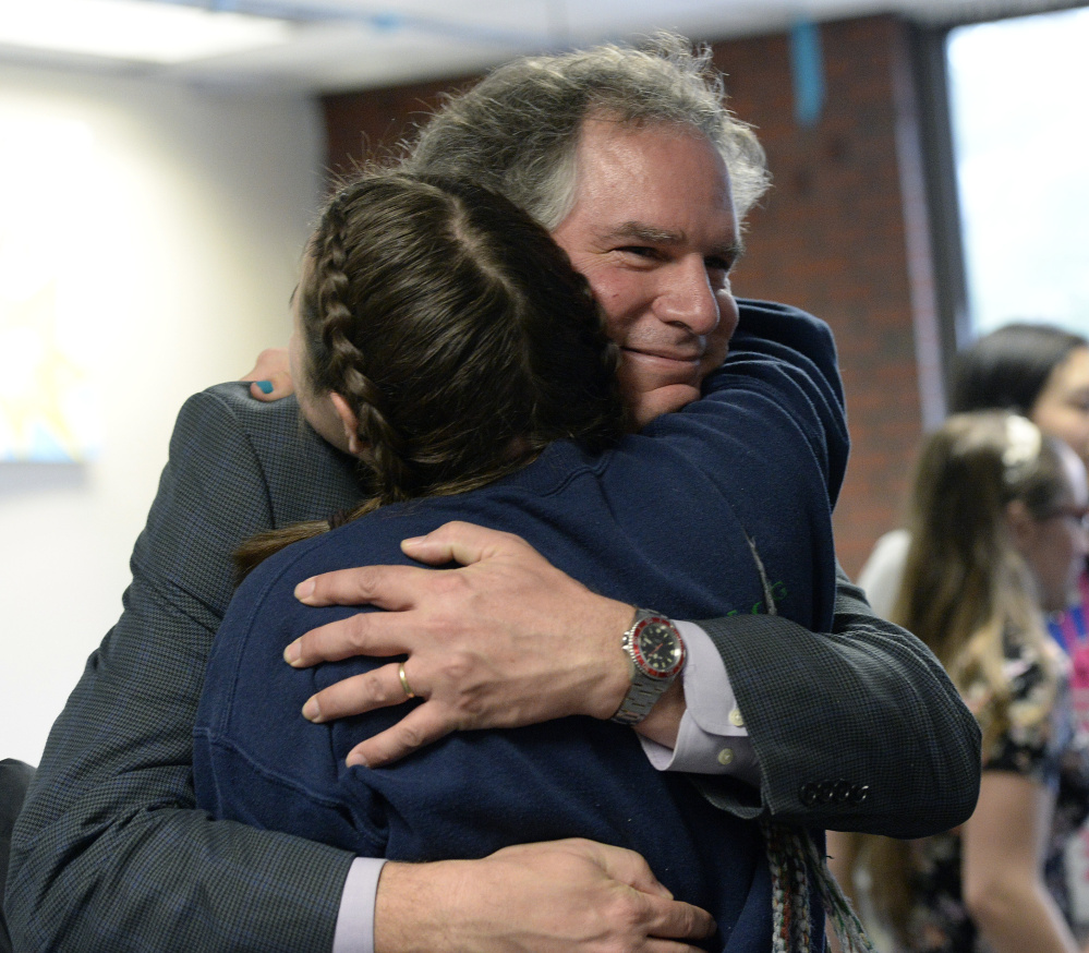 Casco Bay High School Principal Derek Pierce is hugged by a student after being named Maine's Principal of the Year on Monday. Shawn Patrick Ouellette/Staff Photographer