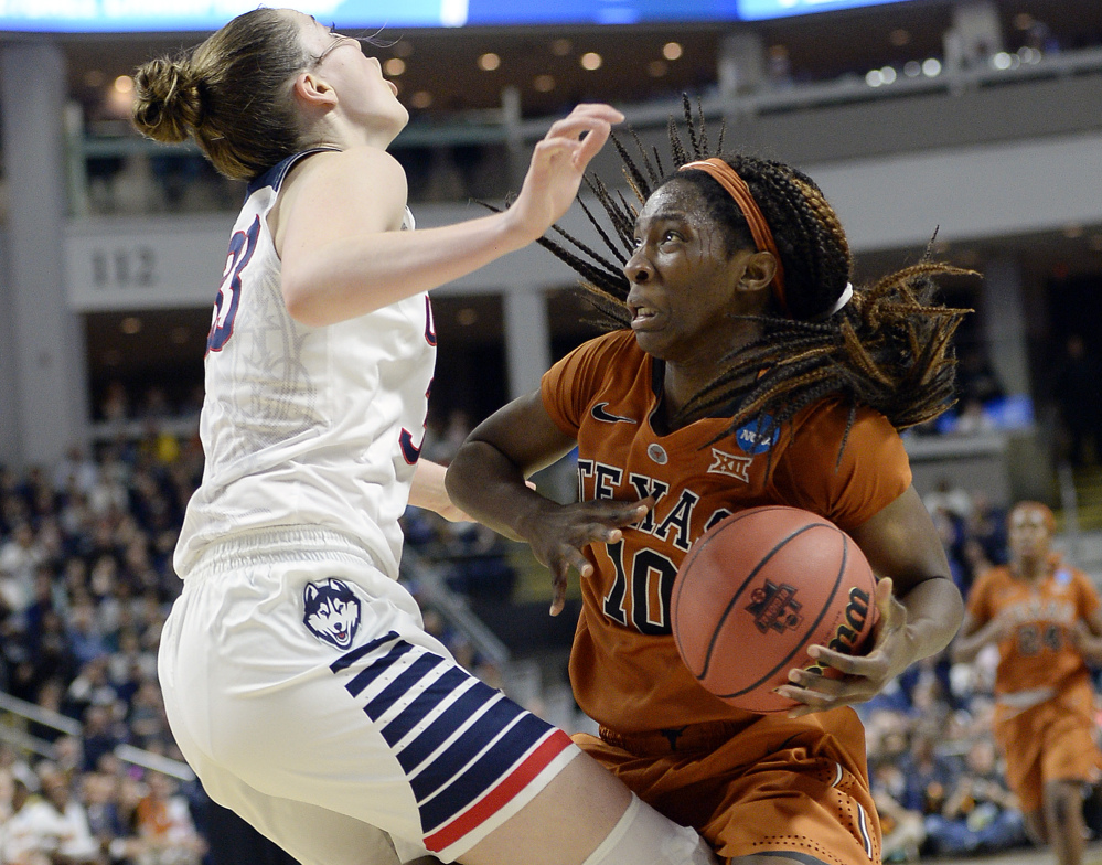 Texas' Lashann Higgs gets little room to move against Connecticut's Katie Lou Samuelson.