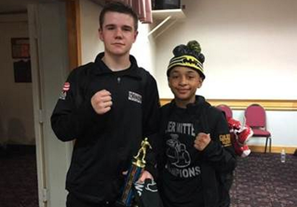 Brady Greenwood, 16, left, and Barry Wilson, 12, both of the Portland Boxing Club, won their classes at the New England Silver Mittens Championship in Billerica, Massachusetts.