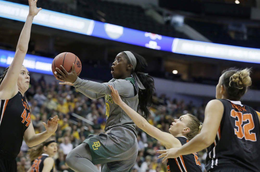 Baylor guard Alexis Jones drives against Oregon State defenders Ruth Hamblin (44), Jamie Weisner (15) and  Deven Hunter in the first half. Jones led Baylor with 19 points.