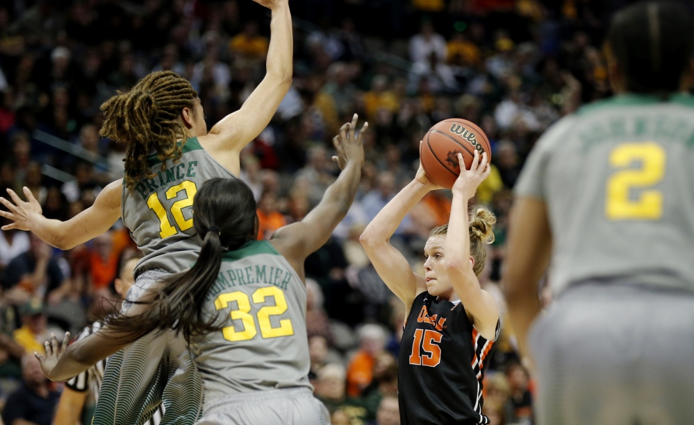 Oregon State guard Jamie Weisner looks for room againt Baylor forward Beatrice Mompremier (32) and guard Alexis Prince in the first half of Monday night's regional final in Dallas. Weisner had 16 points in Oregon State's 60-57 win.
