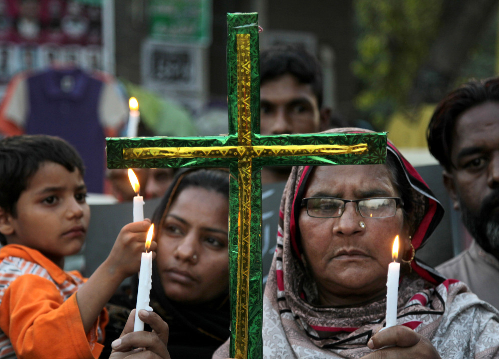 Pakistani Christians hold candles during vigil for the victims of Sunday's suicide bombing in Lahore, Pakistan, on Tuesday. The government had vowed to crack down on extremism after a suicide bomber targeted Christians celebrating Easter in Lahore, killing more than 70 people.