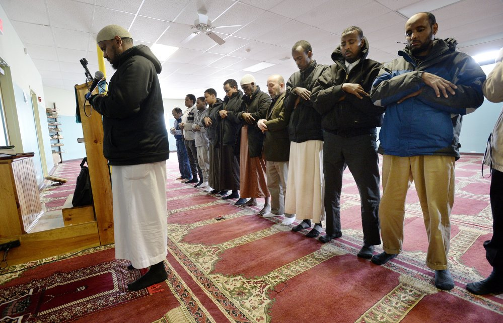 Muslim men pray at the Maine Muslim Community Center in Portland last week. Many of the estimated 6,000 Muslims in Maine – including the center's director, Ahmed Abdiraham, who fled civil war in Somalia – came here to get away from brutality and conflict.