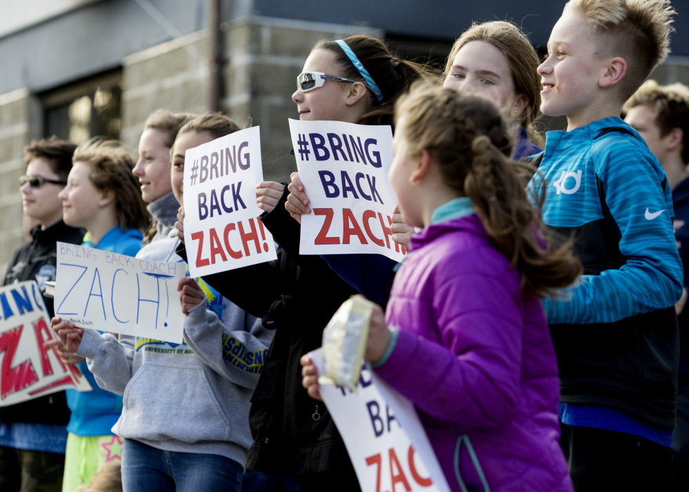 Members of the Manta Rays swim team protest the firing of their head coach, Zach Gray, outside the YMCA in Biddeford on Wednesday. Gray was the head coach for two years and was the 2015 Maine YMCA Coach of the Year.