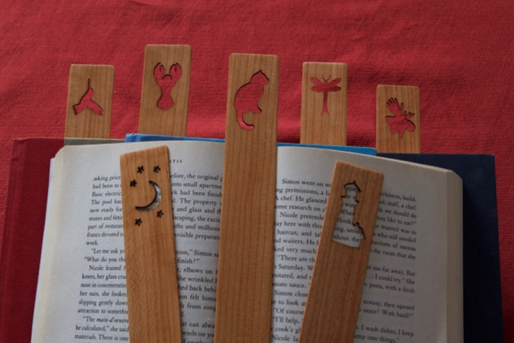 wood wizard laser cuts custom bookmarks with eclectic designs