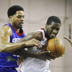 Omari Johnson of the Maine Red Claws protects the ball against Rodney Carney of the Delaware 87ers during the first half action Thursday at the Portland Expo.