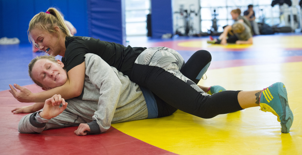 Competing at a lower weight class in the past year, Deanna Betterman, top, wrestles Haley Augello in a practice this week at the Olympic Training Center in Colorado Springs, Colo. Christian Murdock/The Gazette/Special to the Press Herald