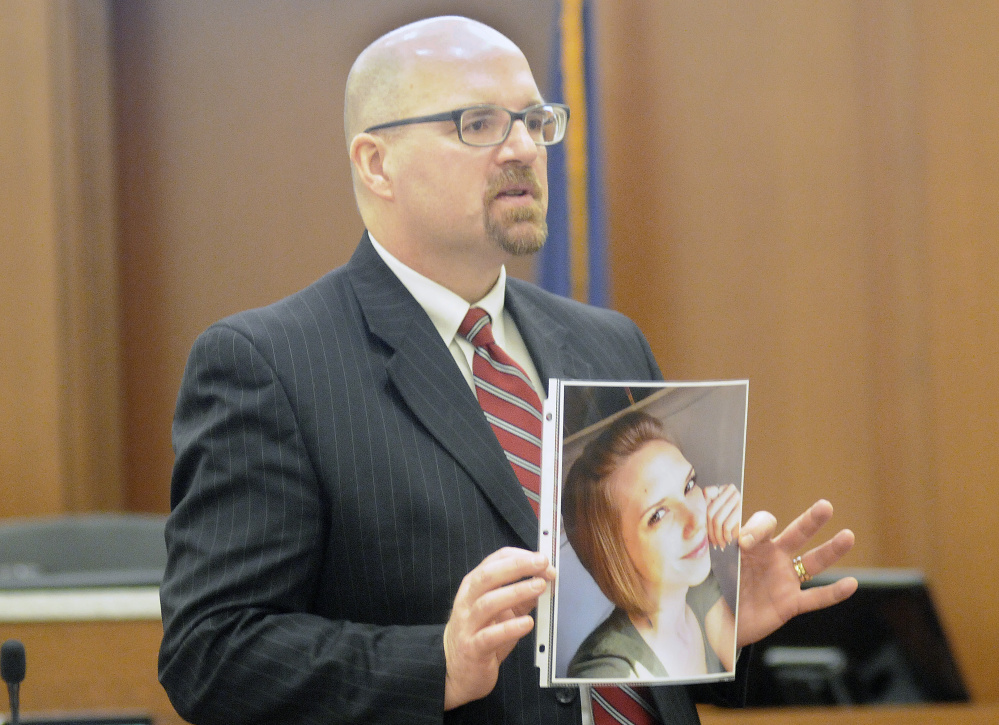 Assistant Attorney General Donald Macomber holds a photo of Jillian Jones during opening arguments in the murder trial of Justin Pillsbury in this March 14 file photo.