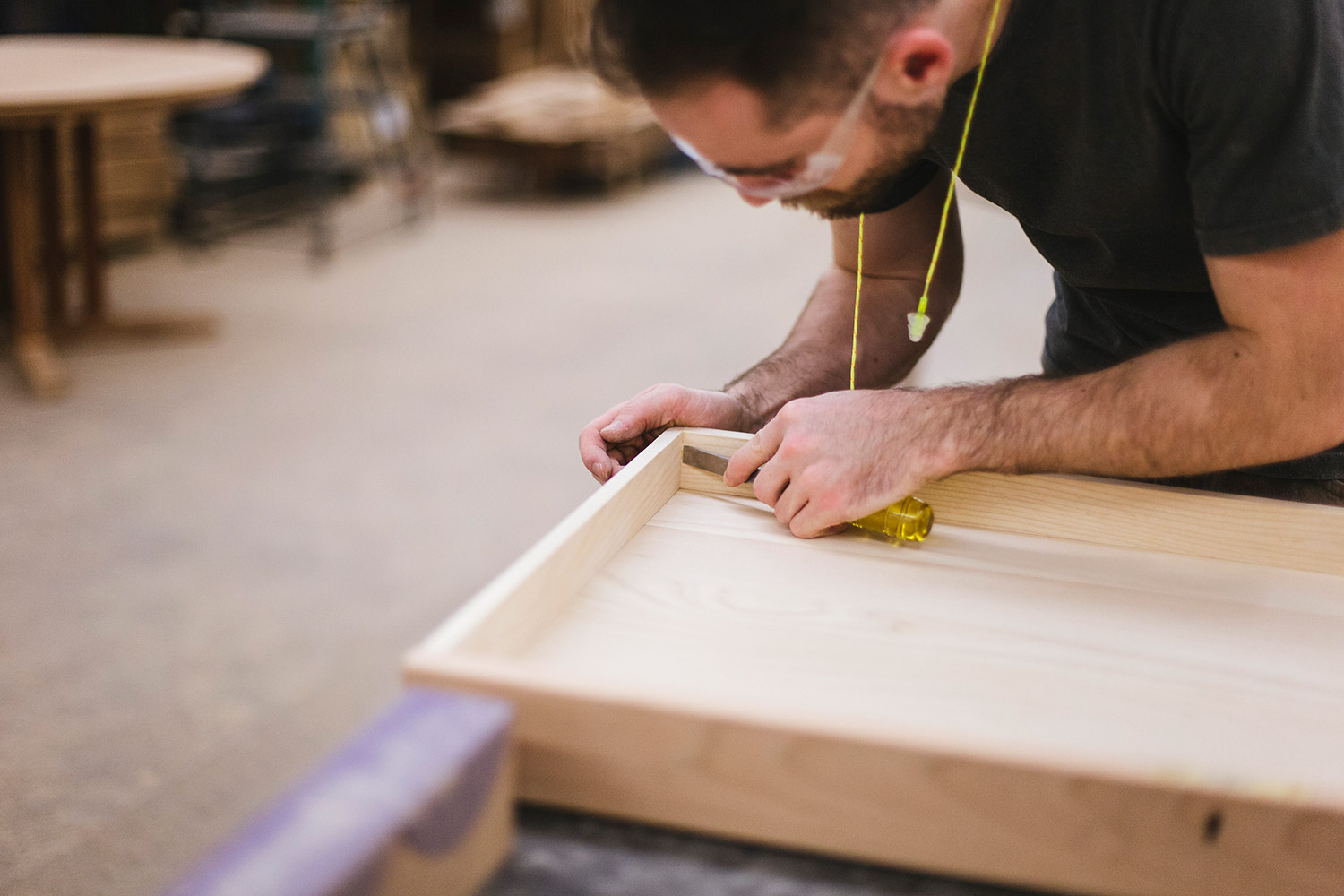 Ian Trundy finishes the edges of a desk drawer. Thomas Moser believes his furniture should last as long as the tree it came from.