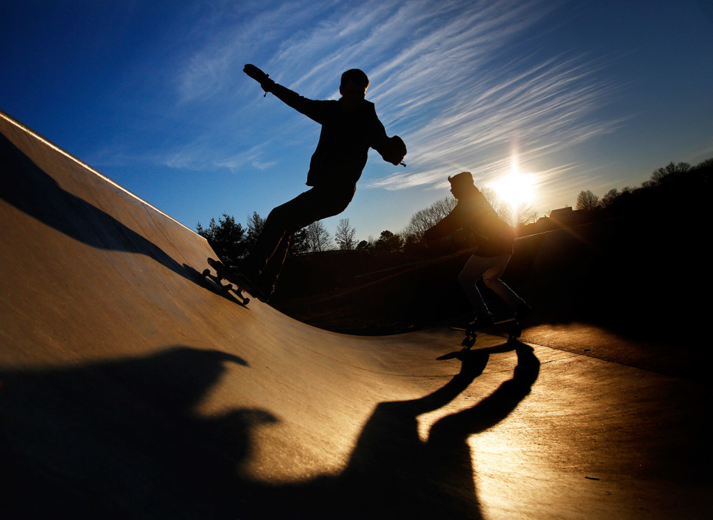 Calvin Shimko, 17, left, and Niko Torres, 17, both of Naples, cast long shadows while riding their skateboards at Dougherty Field in Portland in March. City officials hope to ease overcrowding at the park by doubling its size.