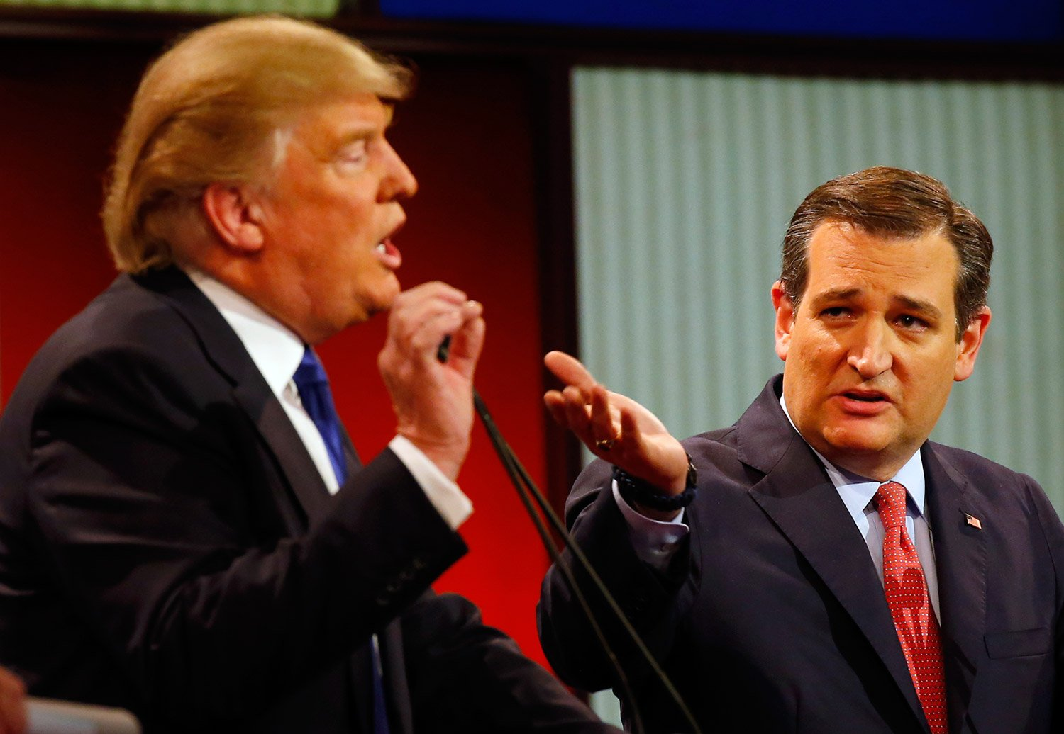 Donald Trump and Ted Cruz argue a point during Thursday night's heated debate. The Associated Press