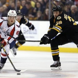 Washington's Andre Burakovsky brings the puck up as Boston's Matt Beleskey defends during the first period in Boston on Saturday. The Associated Press