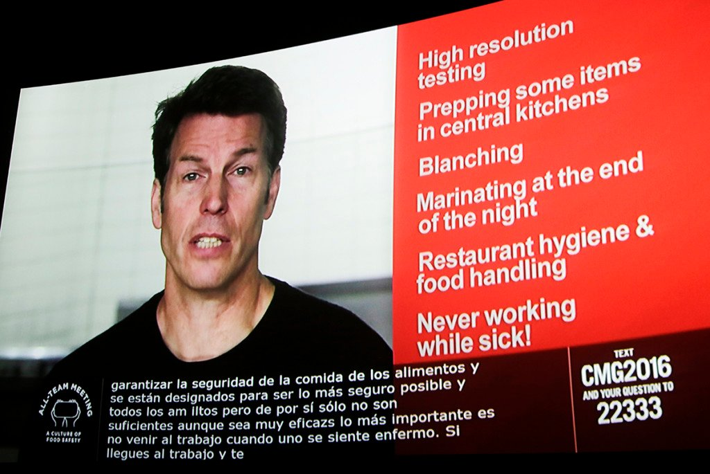 Chipotle co-CEO Monty Moran appears via videoconference as he speaks from Denver to employees nationwide on Feb. 8, 2016, as workers gathered in movie theaters and hotel conference rooms across the country to discuss the chain's recent food safety scares. The Associated Press