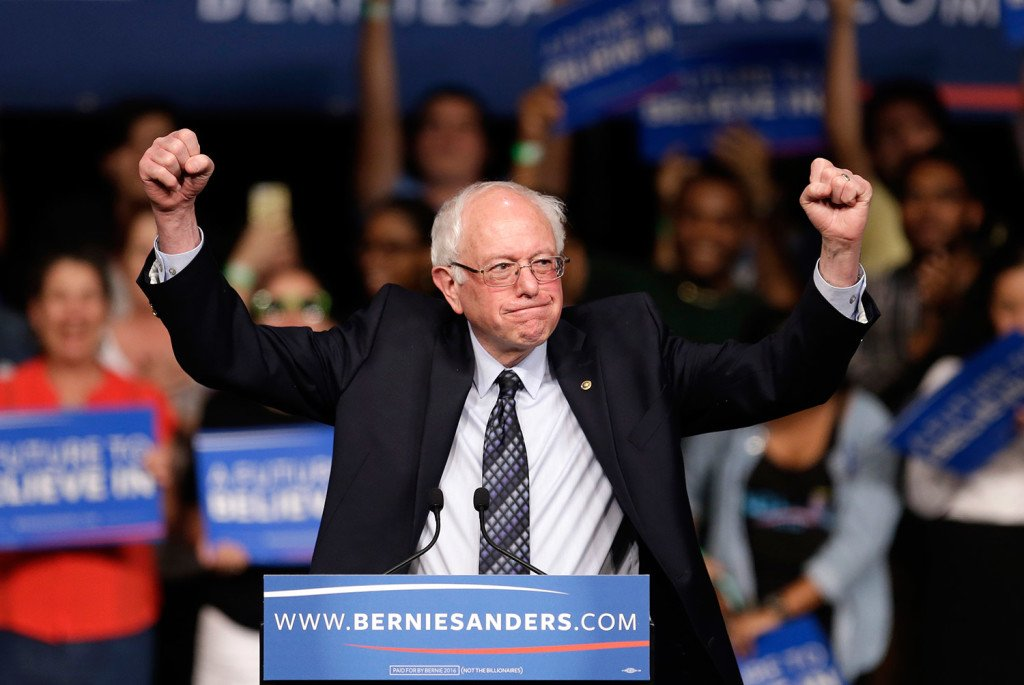 Democratic presidential candidate, Sen. Bernie Sanders, I-Vt. acknowledges his supporters on arrival at a campaign rally Tuesday in Miami.