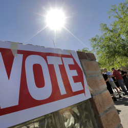 Voters in Gilbert, Ariz., wait in line to cast their ballots Tuesday in Arizona's presidential primary.