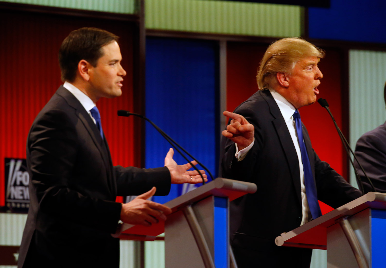 Marco Rubio and Donald Trump argue, as they did through much of Thursday night's debate in Detroit. The Associated Press