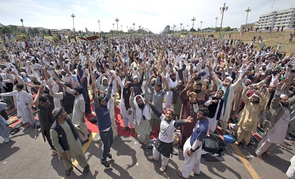 Protesters from Pakistan's Sunni Tehreek group chant slogans during a sit-in near the parliament building in Islamabad, Pakistan, Tuesday,  bringing the most sensitive parts of the nation's capital to a standstill. The Associated Press