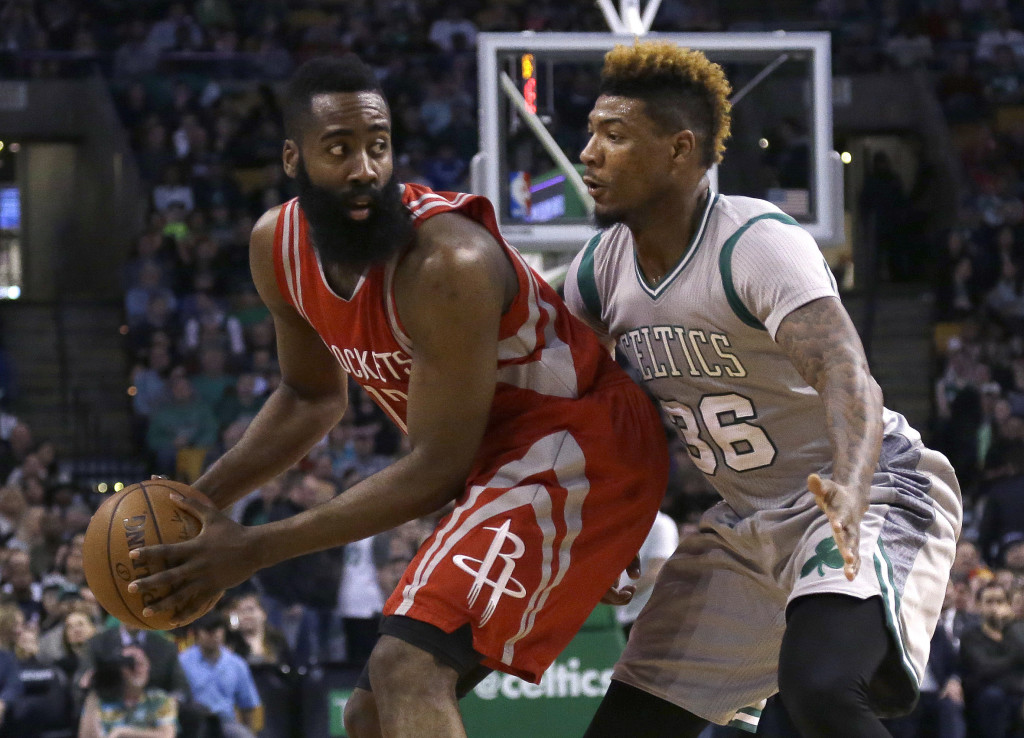 Rockets guard James Harden looks to make a move against Celtics guard Marcus Smart in the fourth quarter Friday in Boston. The Associated Press