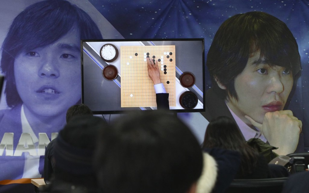 Go fans watch a live broadcast of the Google DeepMind Challenge Match at Korea Baduk Association office in Seoul, South Korea, Wednesday. The Associated Press