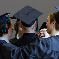 PORTLAND, ME - JUNE 4:  A group of graduates dance in a circle before walking to the Merrill Auditorium for the Casco Bay High School graduation. (Photo by Derek Davis/Staff Photographer)