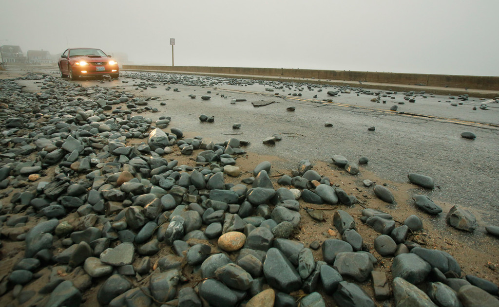 Rocks and seaweed cover Beach Avenue in Kennebunk. Splash over during the high tide overnight created minor flooding issues along parts of the coast.