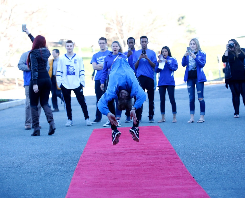 Lewiston High senior Taylor Hopkins flips on the red carpet as Lewiston students arrive Wednesday evening at the 2016 Varsity Maine Awards at the University of Southern Maine in Gorham.