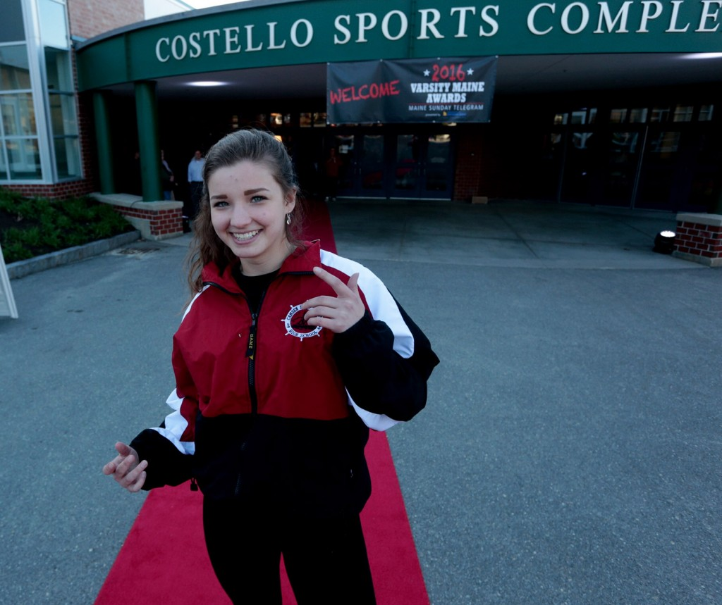 Hilary Merrifield, a Camden Hills senior wrestler who won the Role Model award, poses on the red carpet as she arrives at the Varsity Maine Awards on Wednesday evening.
