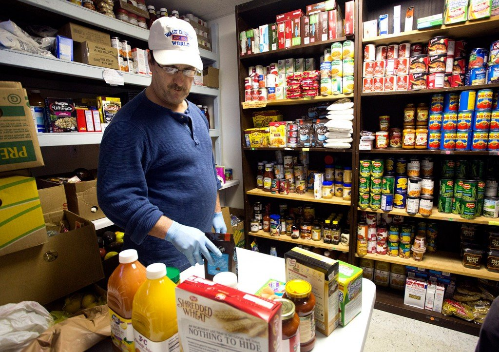 Kurt Fortman, a volunteer, sorts food Monday at the Old Orchard Beach Community Food Pantry, which will lose about a quarter of its food because of the closure of Food Rescue of York County.