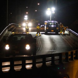 Department of Transportation workers inspect and tighten bolts Wednesday night along a guardrail on the Bath viaduct, where an SUV broke through a guardrail on April 4 and fell to the road below.