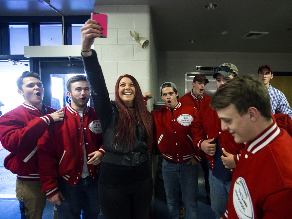"Kristina Williamson, aka ""Krissy"" of the Morning Show at HOT 104.7, takes a video with members of the Gray-New Gloucester football team at the Varsity Maine Awards at Costello Sports Complex in Gorham. Derek Davis/Staff Photographer"