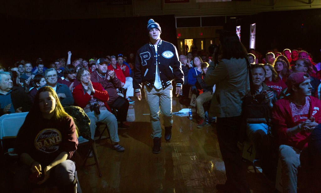 Joe Esposito of Portland High School makes his way to the stage to be awarded Boys' Athlete of the Year at the Varsity Maine Awards at Costello Sports Complex in Gorham. Derek Davis/Staff Photographer