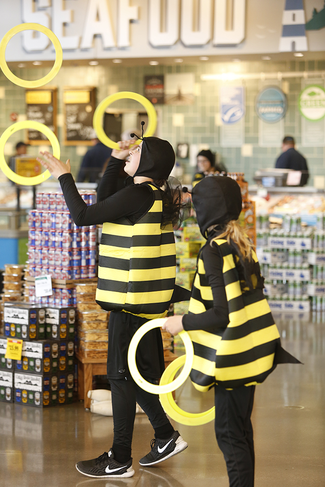 The acrobats are dressed like bees to bring attention to the importance of pollinators. Carl D. Walsh/Staff Photographer