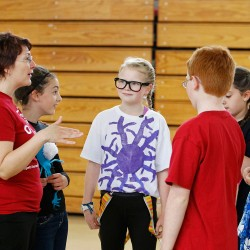 Emily Seavey, center, listens as coach Melanie Desjardins, left, speaks with Team B about their production. From left are team members Sammy Desjardins, Seavey, Declan McPartlan, Ella Romano and Jack Armstrong. Two teams from Lyseth Elementary, including Adrian Boothby and Hannah Dionne (not pictured), are rehearsing for the competition.