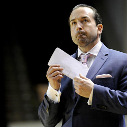 Maine Red Claws Coach Scott Morrison looks toward the scoreboard in the second half. Gabe Souza/Staff Photographer