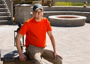 Ken Fengler sits near a pool patio and fire pit he built in Scarborough.