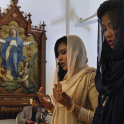 Women pray during Easter Mass at St. Joseph Cathedral in Rawalpindi, Pakistan. There are about 100 million more religiously affiliated women on the planet than men.