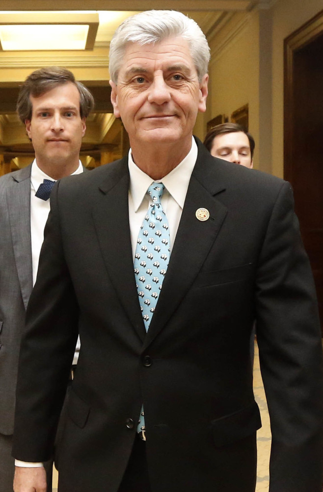 Mississippi Republican Gov. Phil Bryant leaves a news conference Friday.